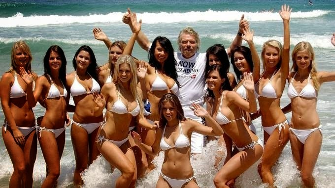 Richard Branson with bikini babes