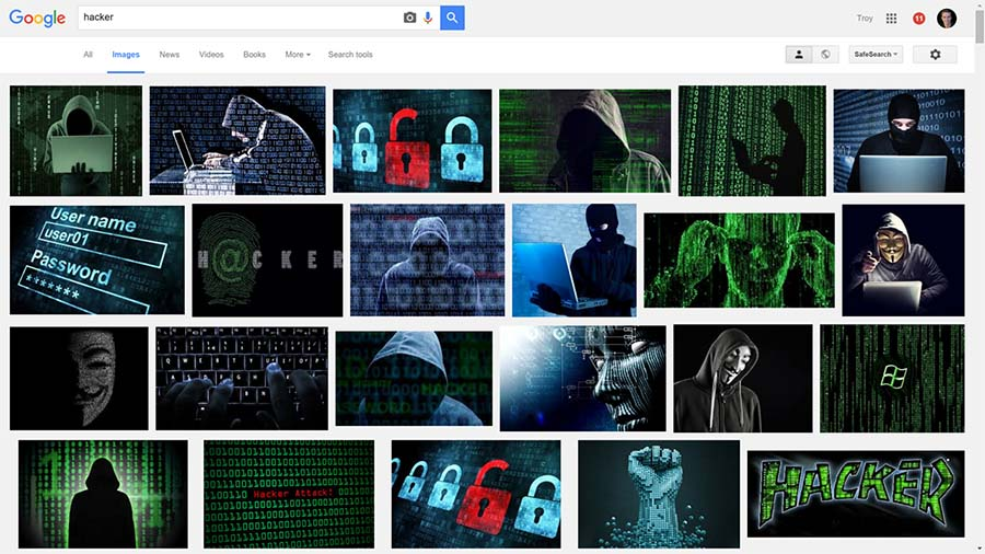 Images of hackers all with hoodies and green screens on a Google Images search